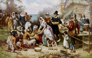 The Pilgrims and the Indians celebrating the first Thanksgiving.